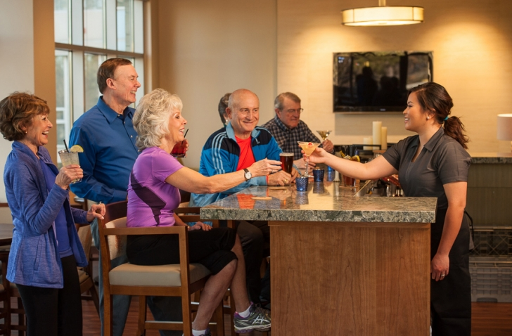 Rockwood Retirement Communities Spokane Elderly Group Getting Drinks In Lounge